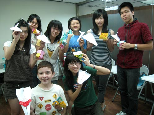 My summer camp students with their paper transformer and aeroplane